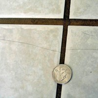 Extended Crack Across Multiple Tiles (Subfloor Movement)