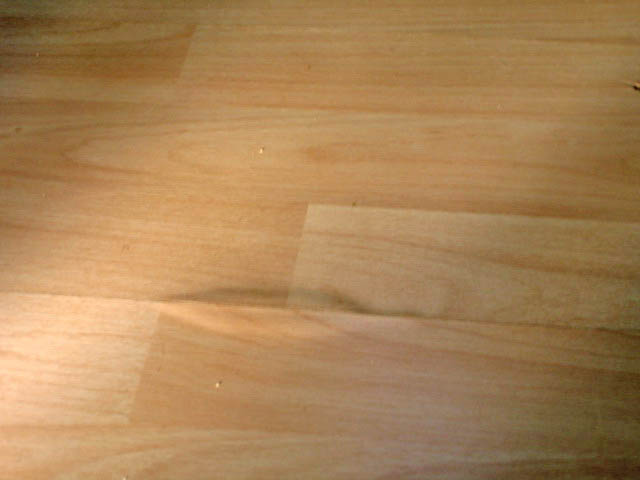 How to fix swollen laminate flooring thefloors co for Laminate flooring services